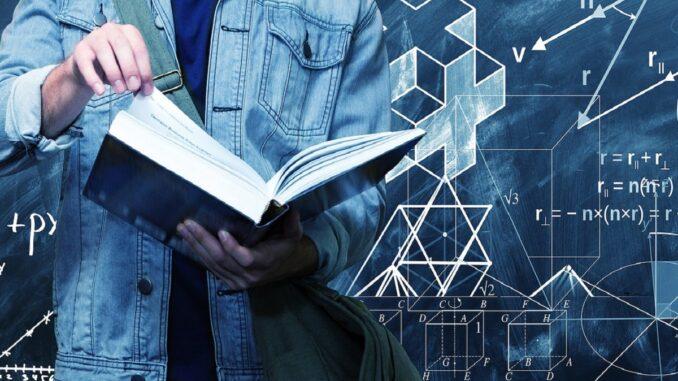Student čte knihu o fyzice